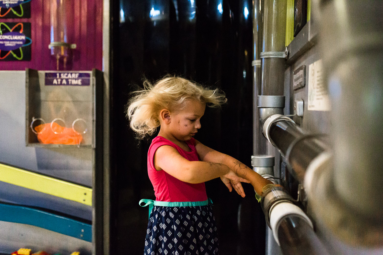 Girl with hair blowing at children's museum