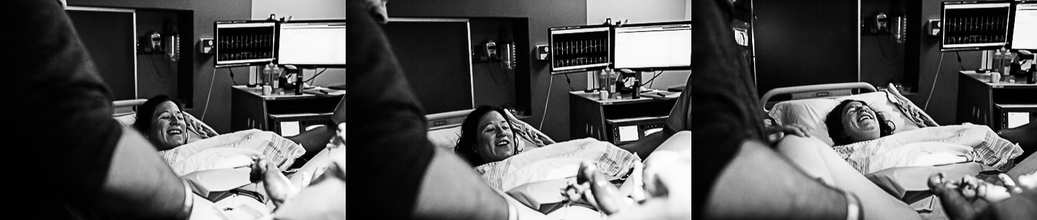 woman seeing daughter for the first time after birth