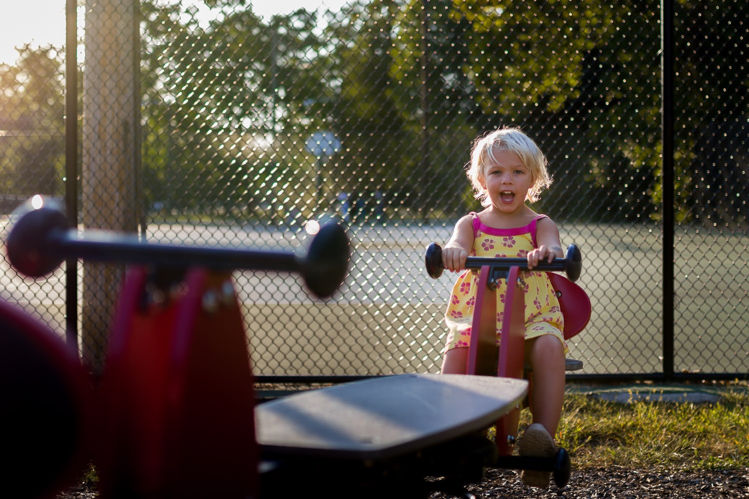 candid photo of girl on seasaw in New Jersey park