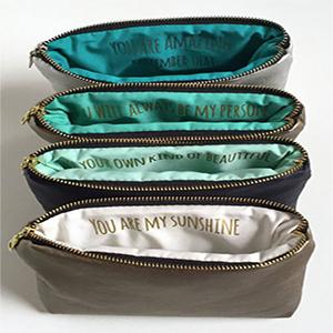 Sandra Smith – Gold Vegan Leather Makeup Bag ($36)