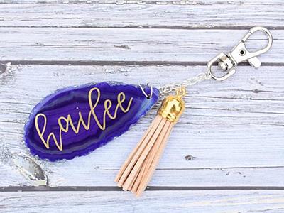 Adorned Keys – Monogram Agate Slice Keychain with Tassel ($10)