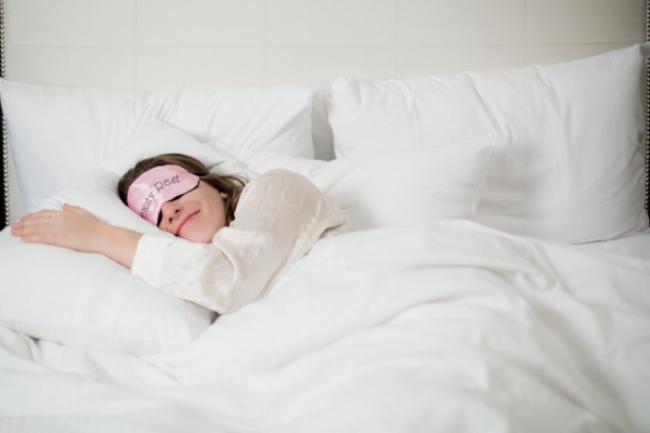 woman-sleeping-in-white-bed_4460x4460.jpg
