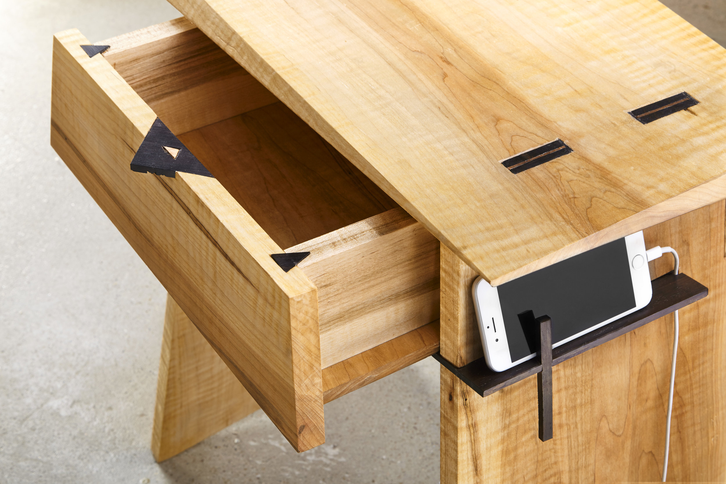 Edo Side Table: the ebony drawer slide also functions as a separate charging shelf
