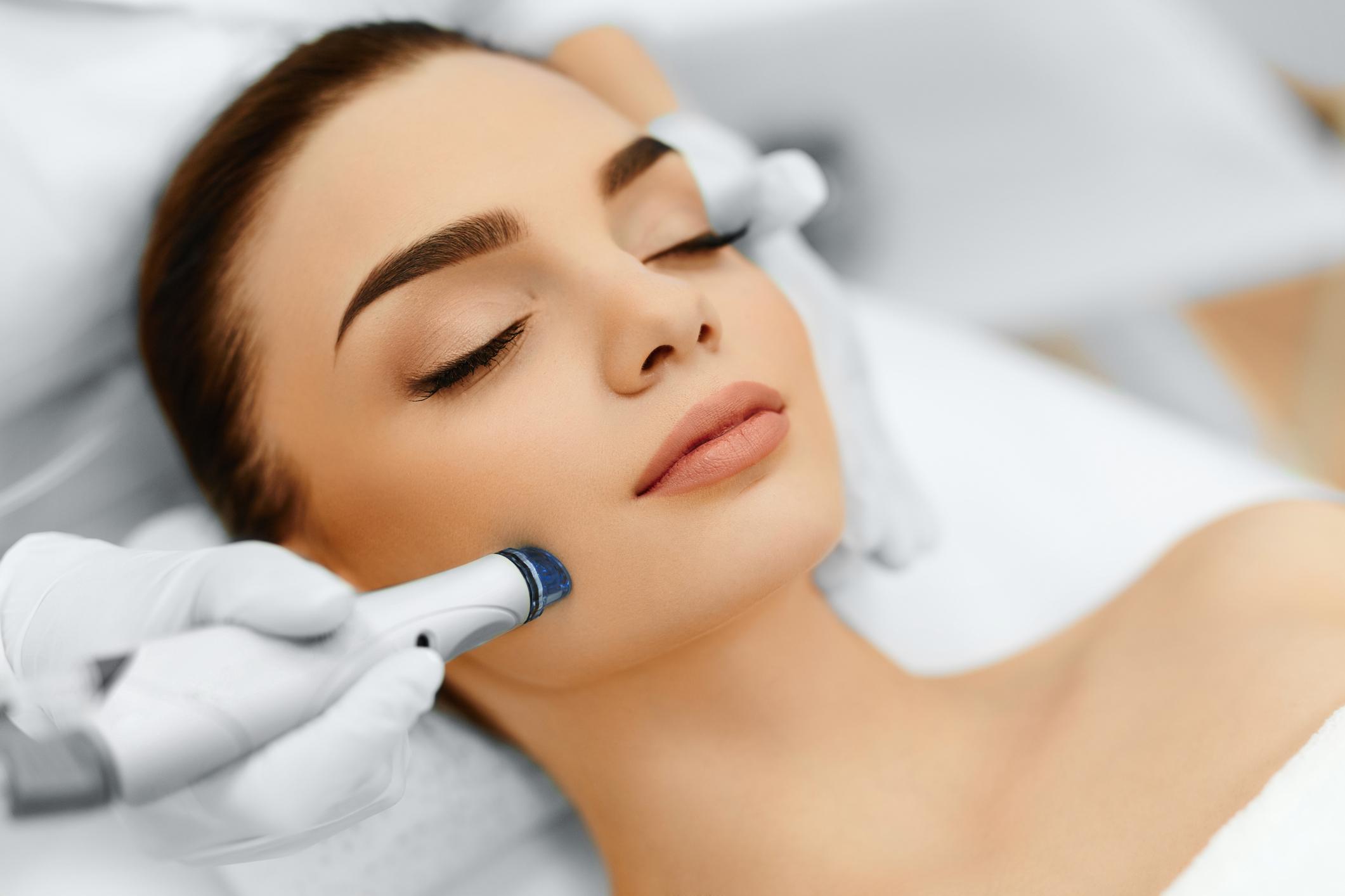 face-skin-care-facial-hydro-microdermabrasion-peeling-treatment-63738624.jpg