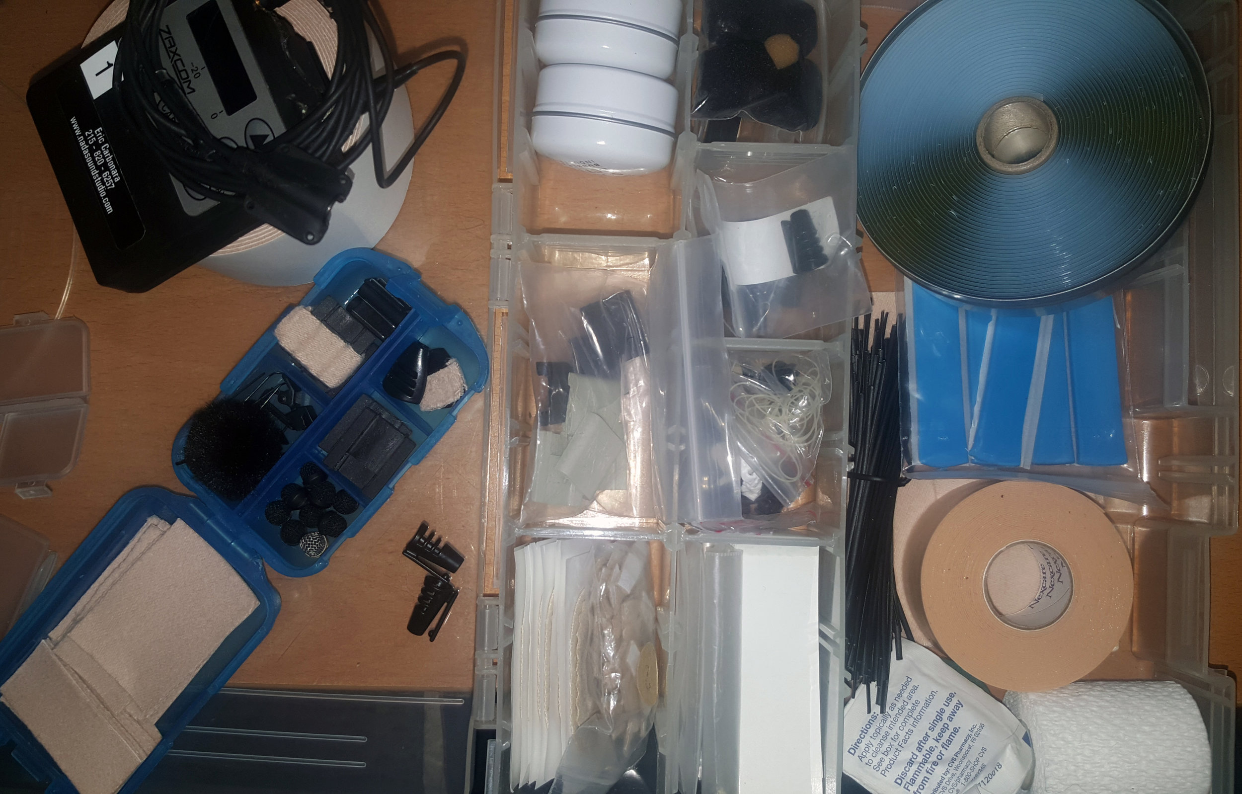 An assortment of mounts and adhesives that are typically used when wiring up an actor.