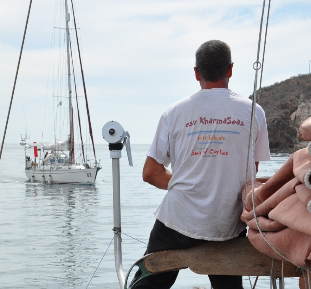 Pitt Bolinate on  KharmaSeas  greets Jeanne Socrates as she arrives in San Carlos, Sonora, Mexico.