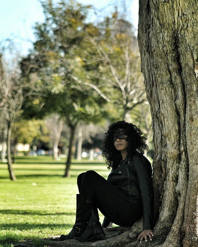 You know where to find me. . . . . . #park #parksandrec #nature #trees #outdoor #noho #tall #masquerade #curls #boots #leatherjacket #leather #greenery #grass