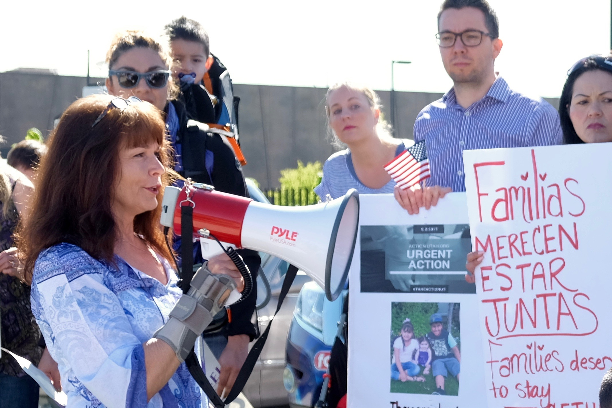 Sharlee Mullins Glenn, a founder of Mormon Women for Ethical Government, speaks to the press and a crowd of demonstrators in West Valley City, Utah. (May 3, 2017)