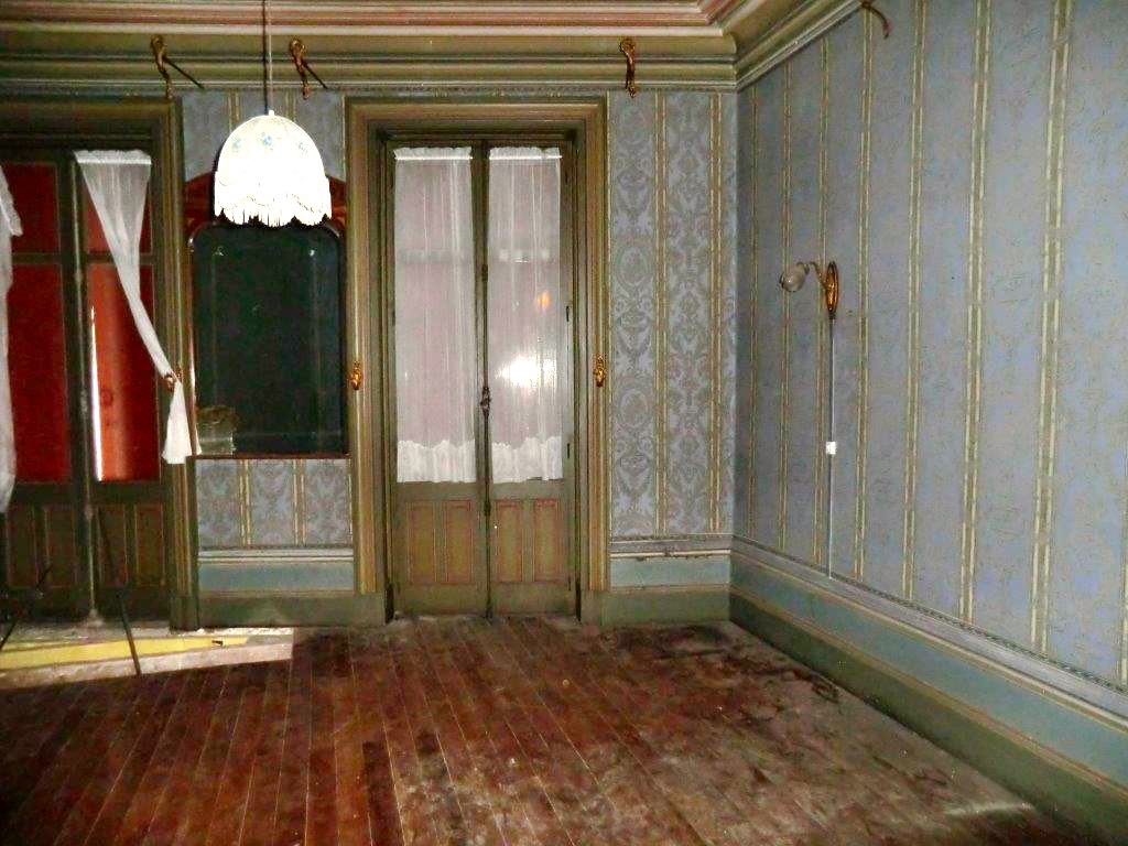 i loved this room immediately even with its 50 years of dust and neglect. The lovely French doors with their solid metal Cremone bolts.
