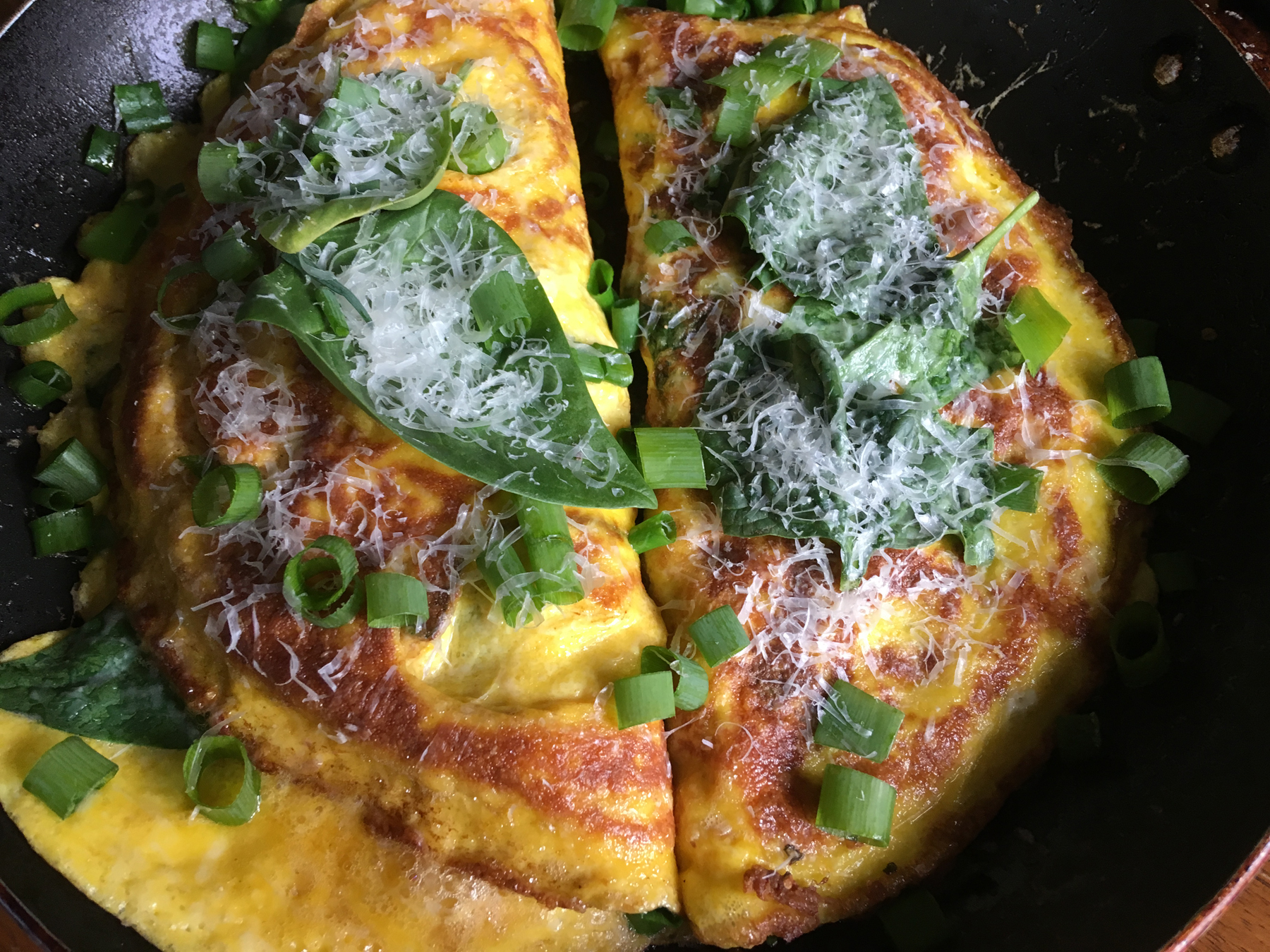 Jason worked as a cook at Family Ties, in Townville, from age 16 until his mid 20s. In those years, he learned to cook from some wonderful people. We've been craving the farm's greens. This omelette is filled with PTF spinach, green onions, and chives. The eggs came from Grandma Darlene's chickens.