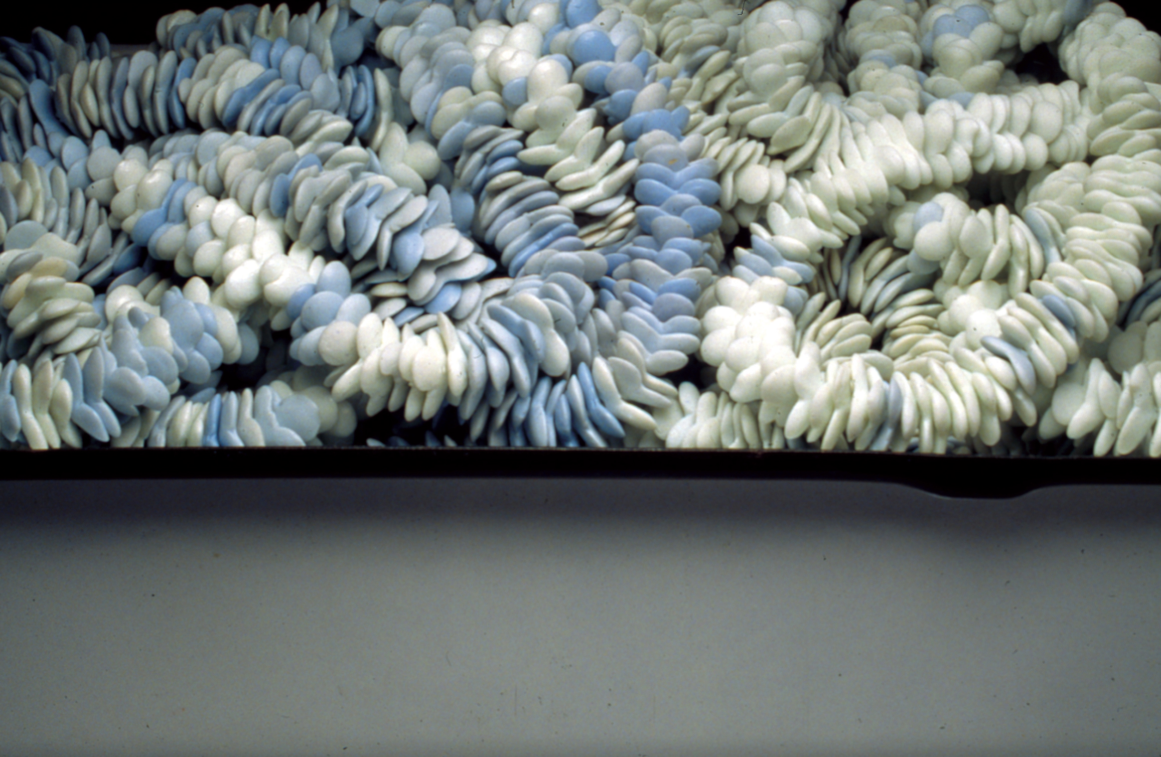 """detail of  <i>frail hope, internal distance: object II</i>, porcelain, metal drawer, c/10 red. and ox. fired, h. 6"""" x w. 15"""" x d. 11"""", 2002"""
