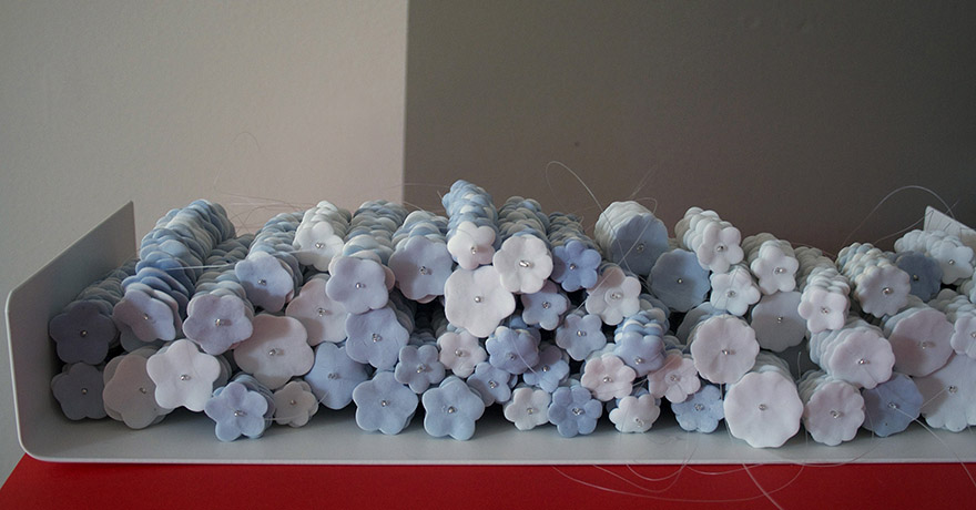 "<i>frail hope, internal distance: object XI</i>, porcelain, mono filament, metal shelf, h. 2 1/2"" x w. 15"" x d. 6""  2013"