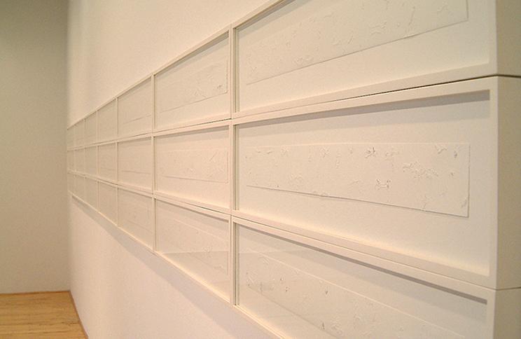 "<i>December Seeder</i>, (36 panels), paper, thread, h. 3"" x w. 30"" (whole unit framed: h. 24"" x w. 420""), 2004"