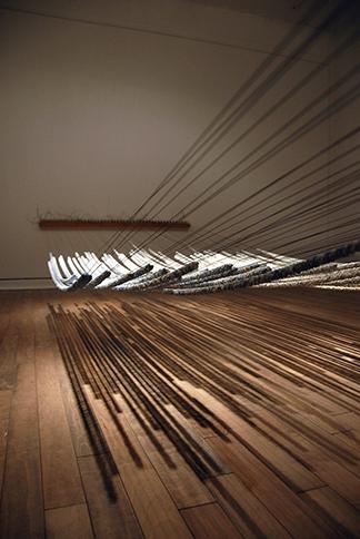 """<i>Between the Petals II</i>, porcelain, piano tuning block, pins, wire, h. 40"""" x w. 192"""" x d. 60"""", 2010"""
