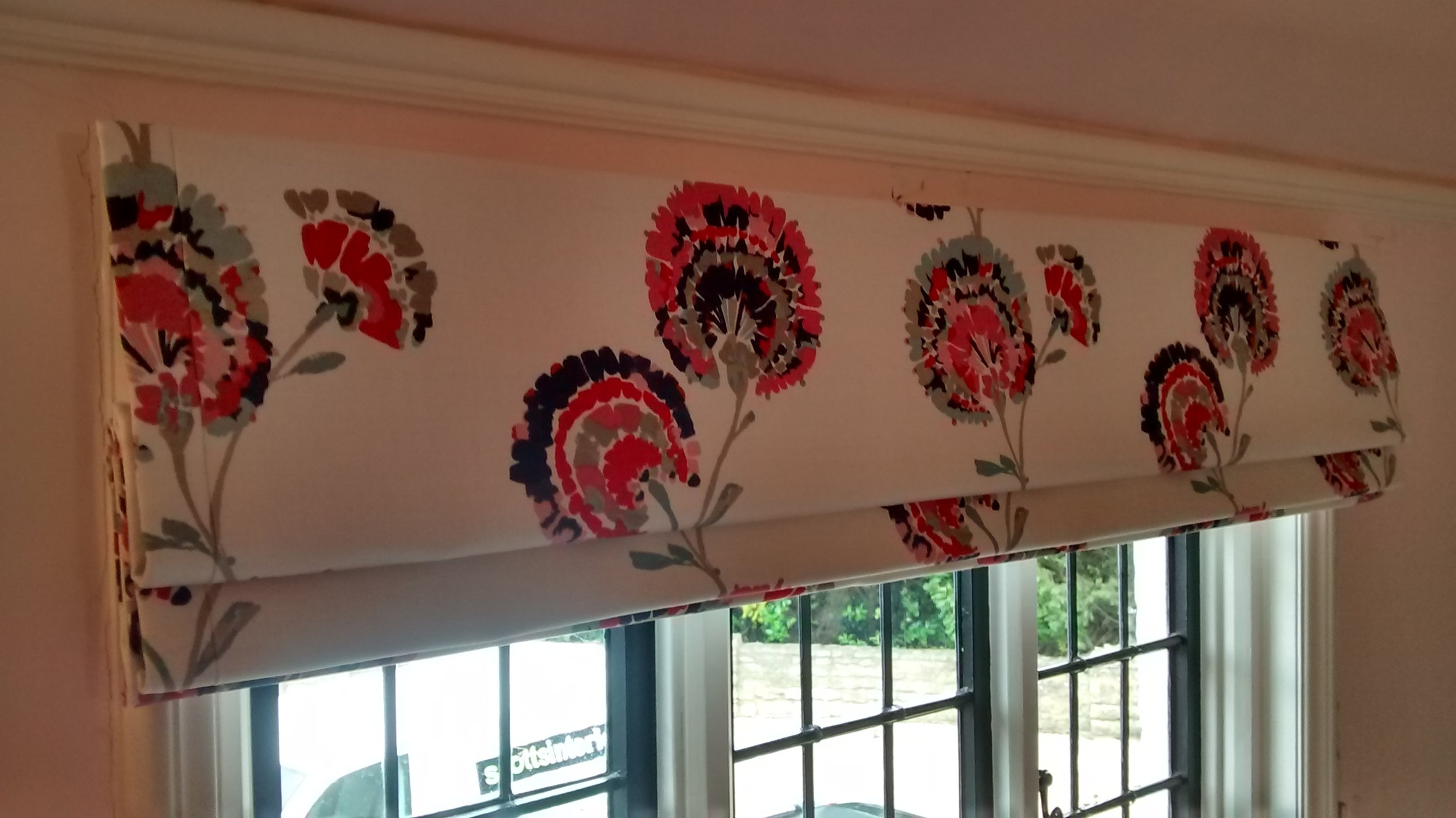Red and cream floral roman blinds
