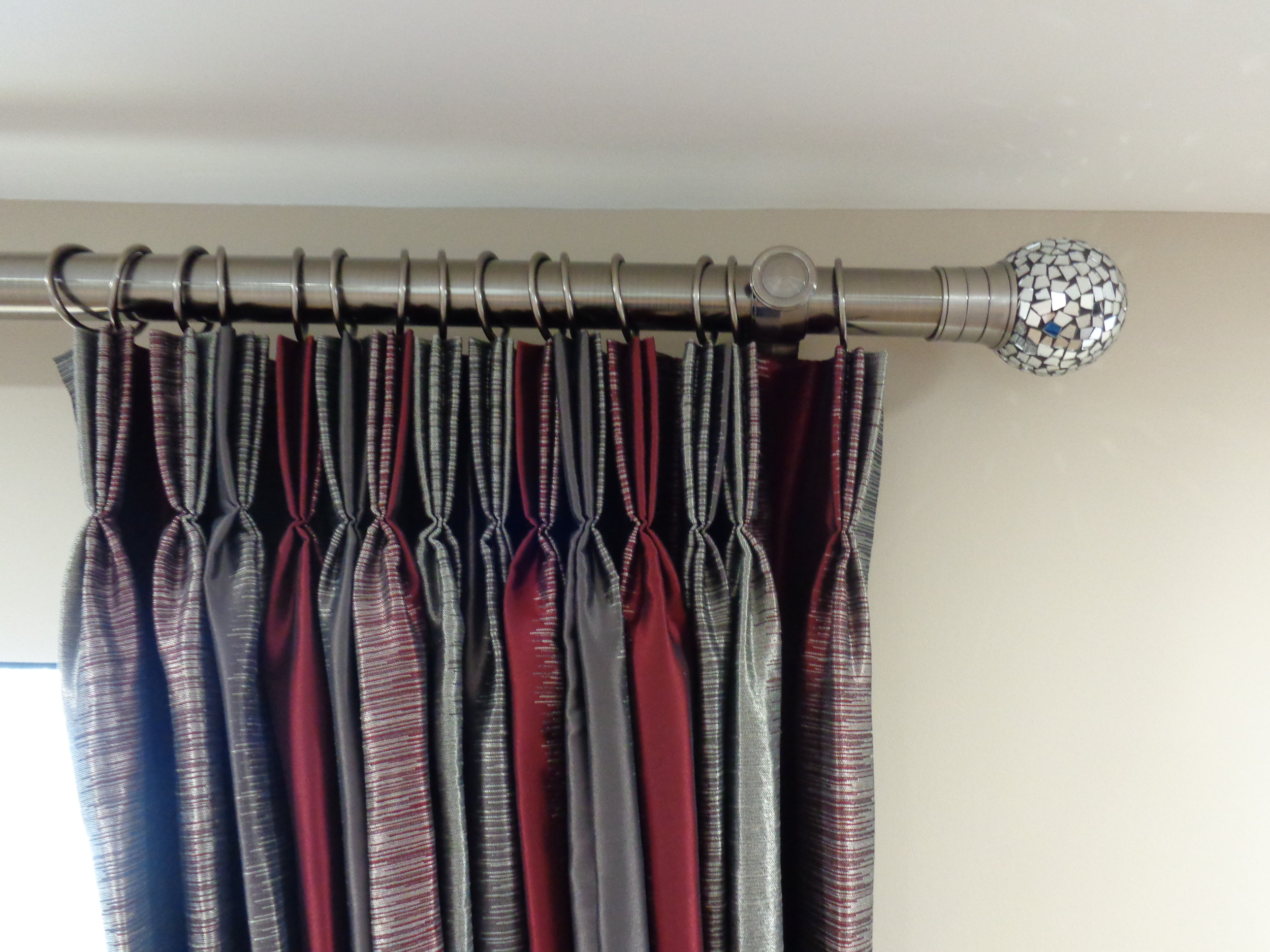 pinch pleat curtains in red and grey