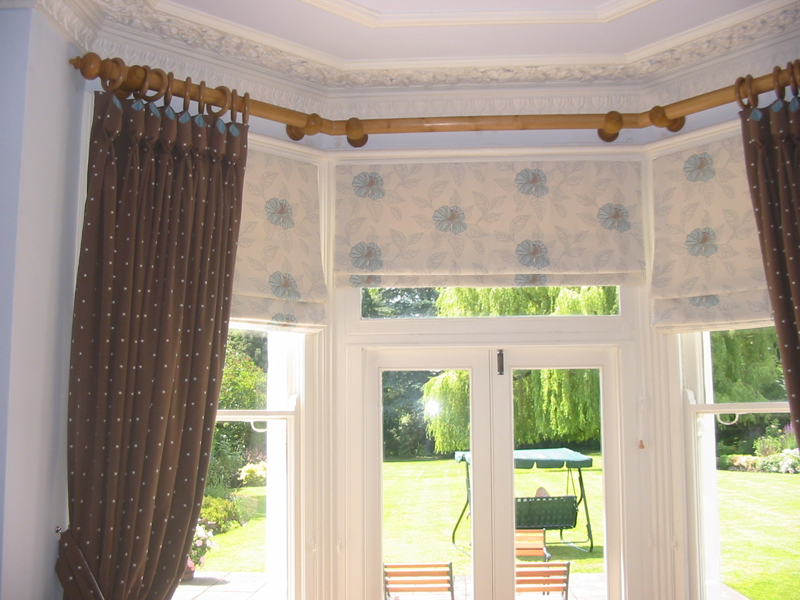 cream and blue roman blinds with box pleat curtains