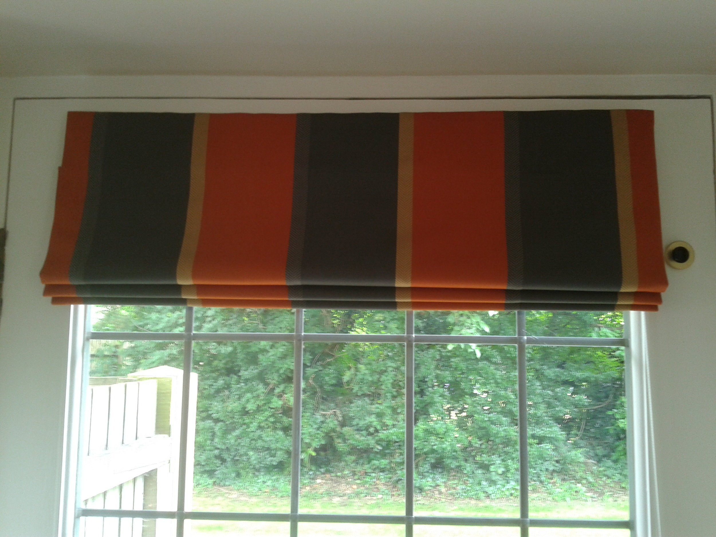 red and black stripe roman blinds