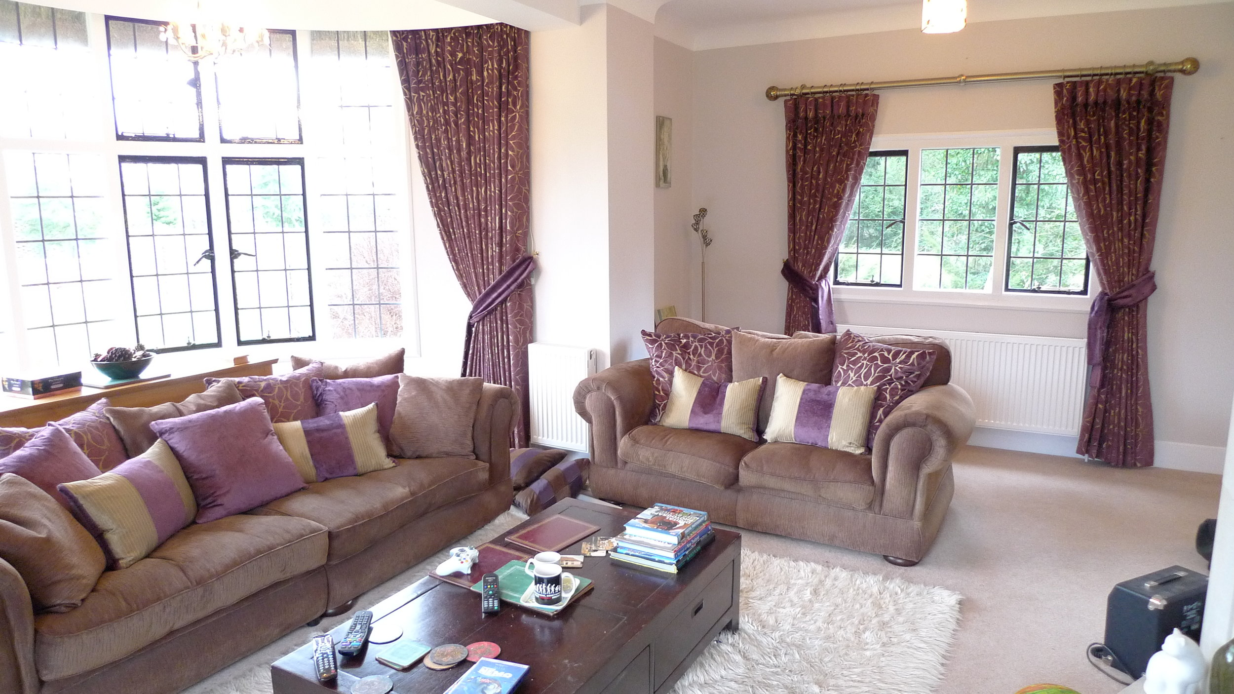 purple curtains and matching cushions in a living room
