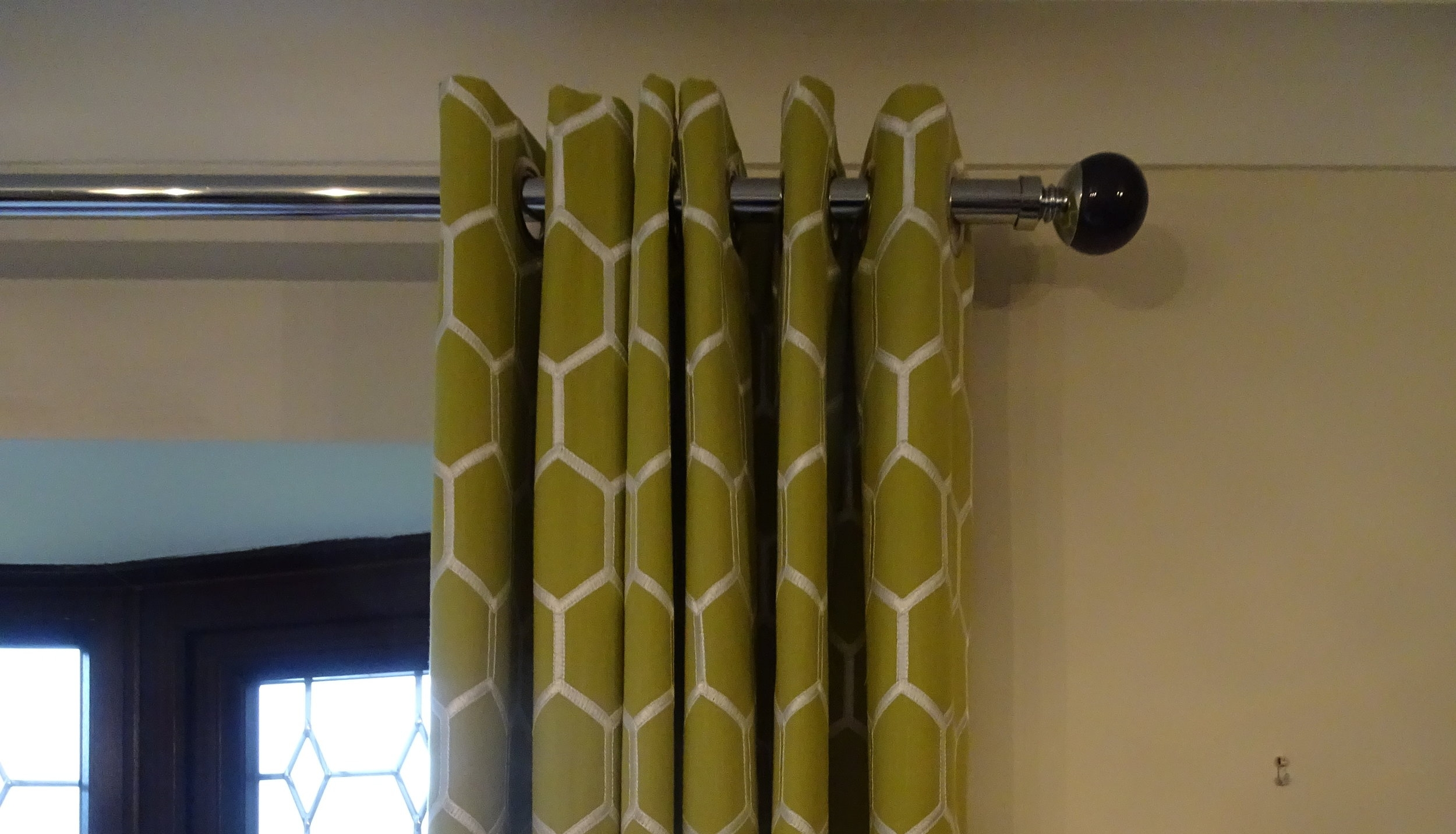 Green Geo style eyelet curtains
