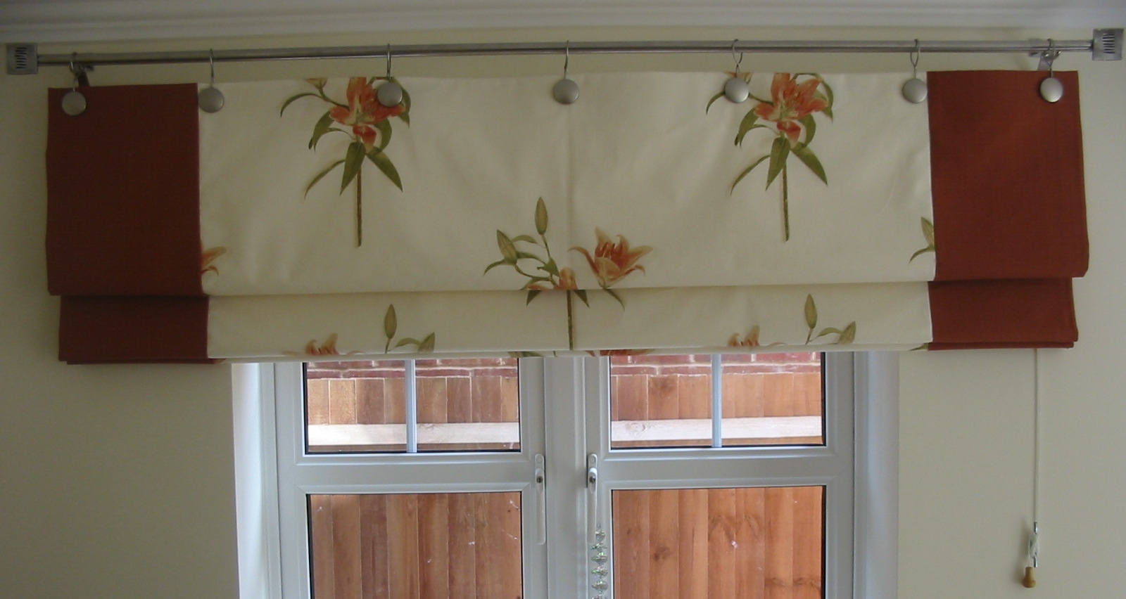cream floral roman blinds for back door