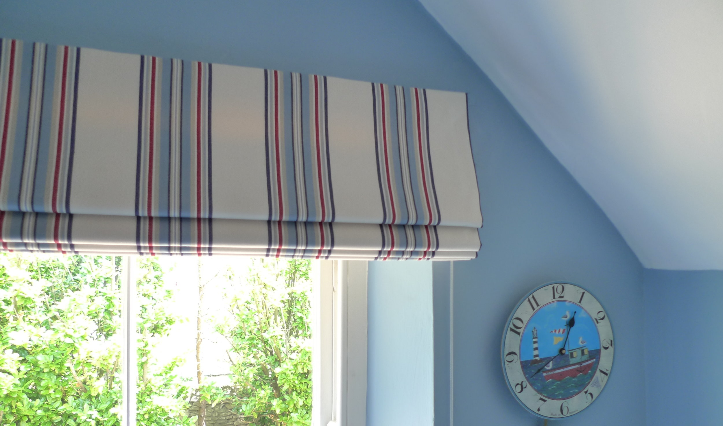 blue and red stripe roman blinds