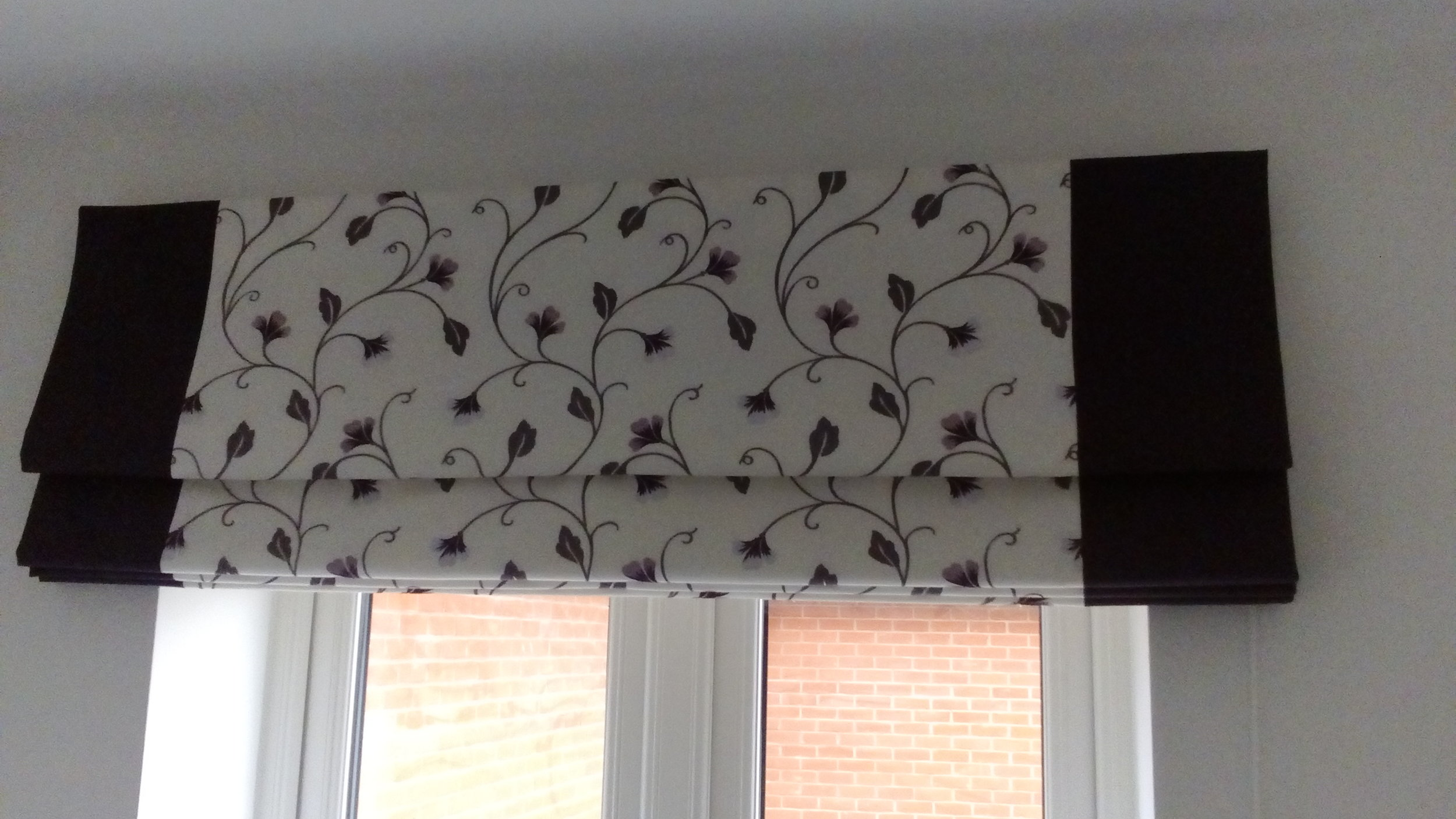 cream and purple roman blinds