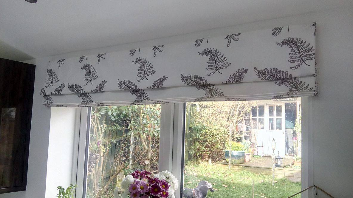 grey and white roman blinds