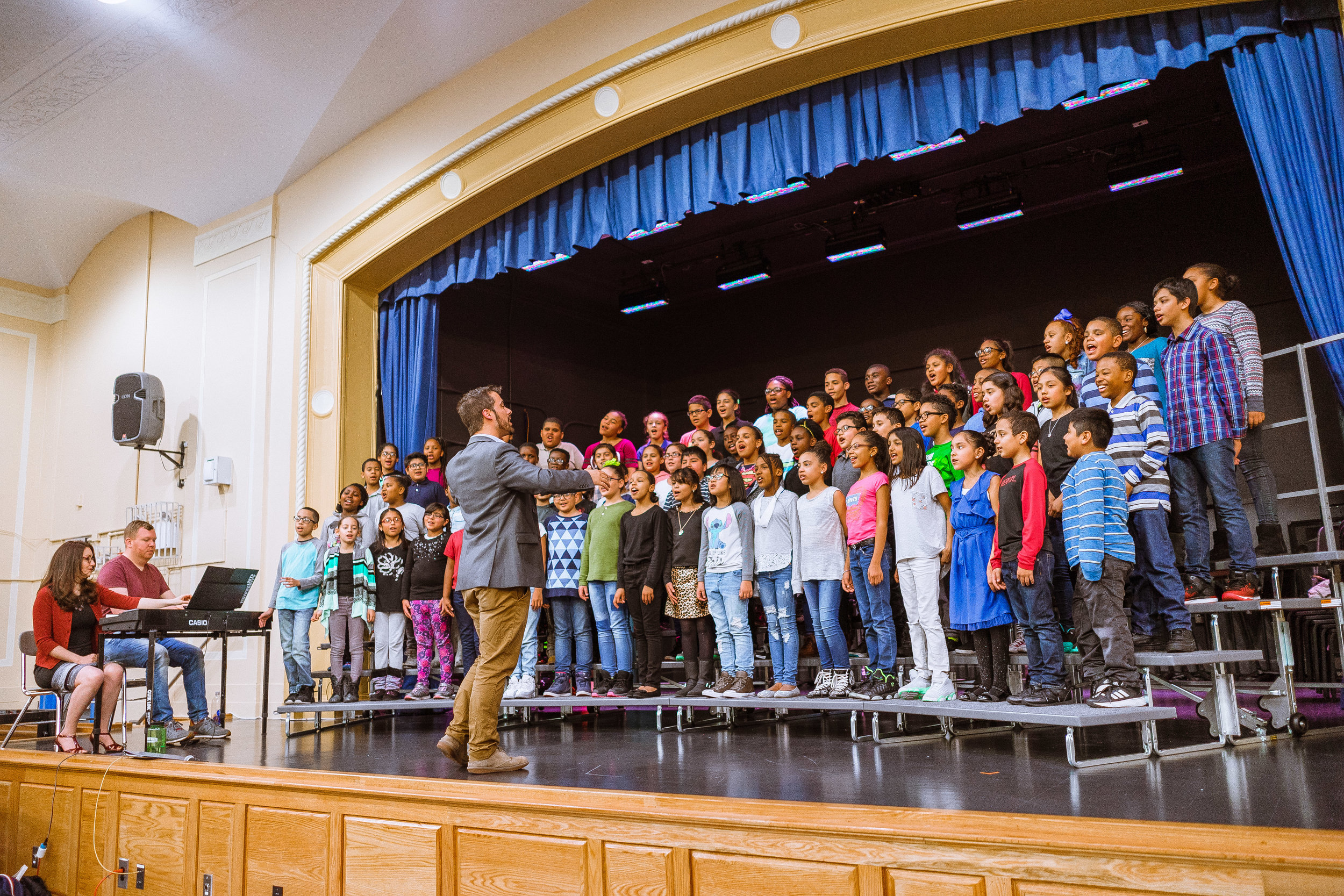 The P.S. 91x Select Choir performing in the school's auditorium.