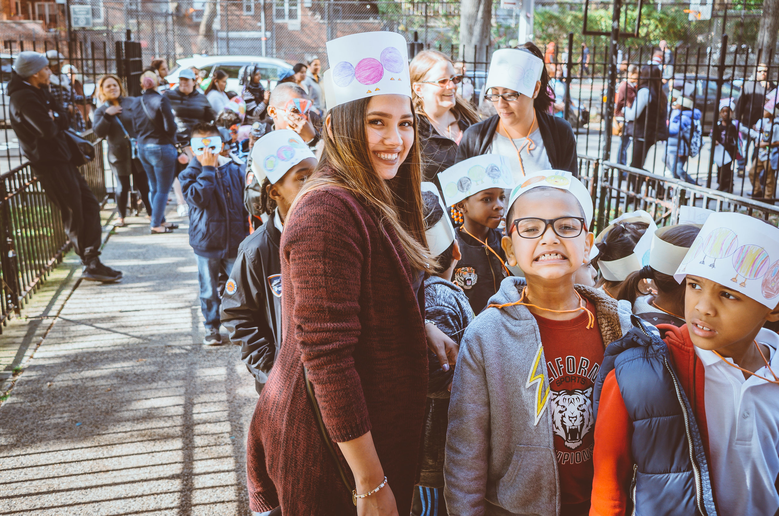 Students and teachers took to the streets as parents marveled at the ingenious hats, masks, and costumes.