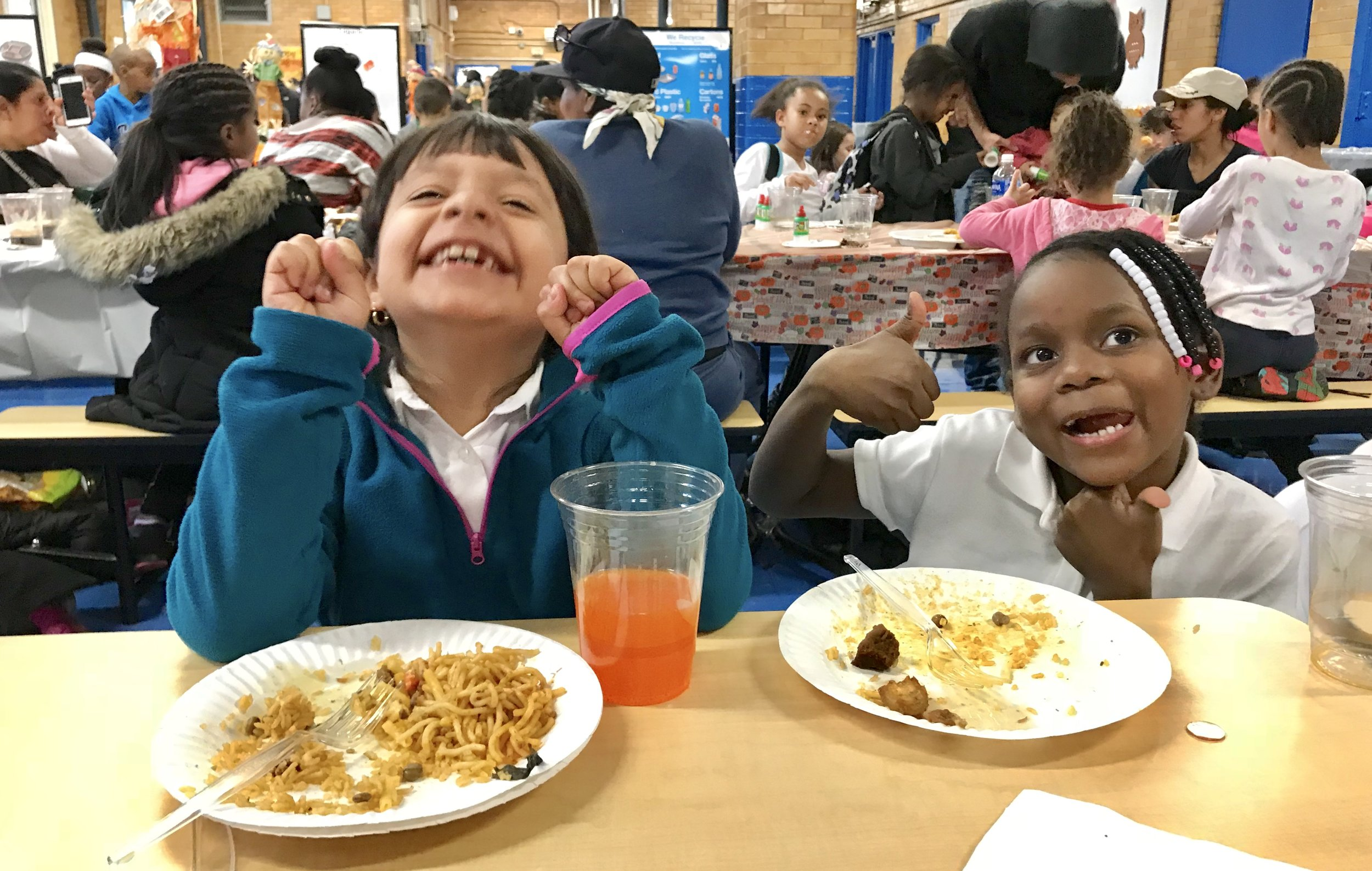 Smiles aplenty at the annual P.S. 91x Thanksgiving Feast.