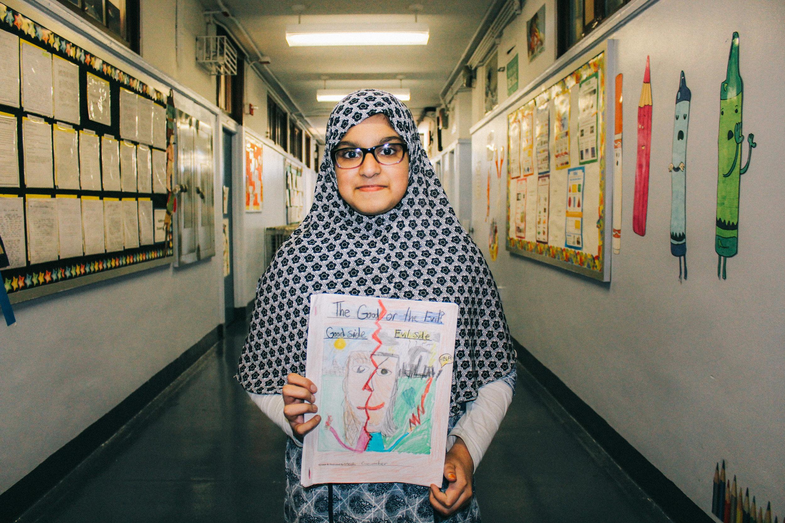 Mosfirat Ubaid holding her very own Firebolt comic.