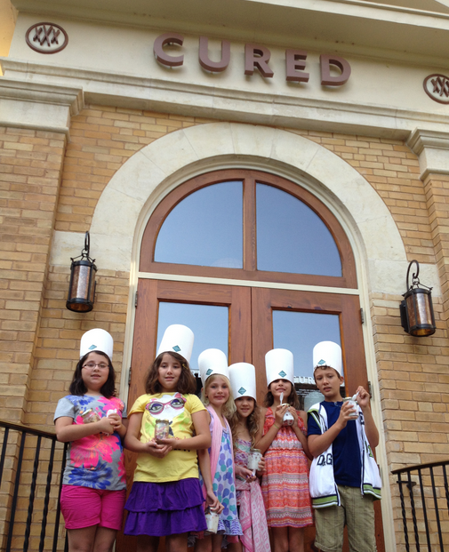 Children gathered at Cured for a Cooking Class benefitting Share Our Strength