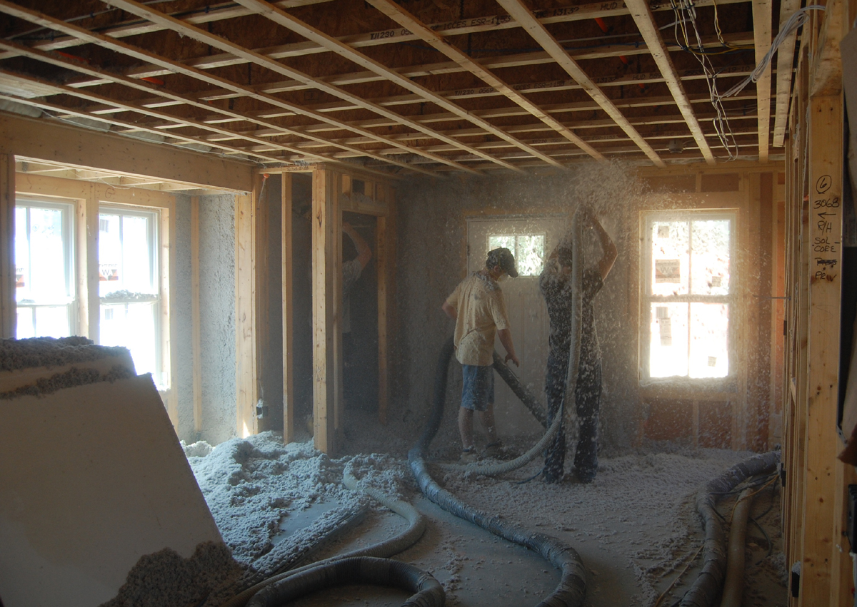 Blown in cellulose Insulation being installed at a project