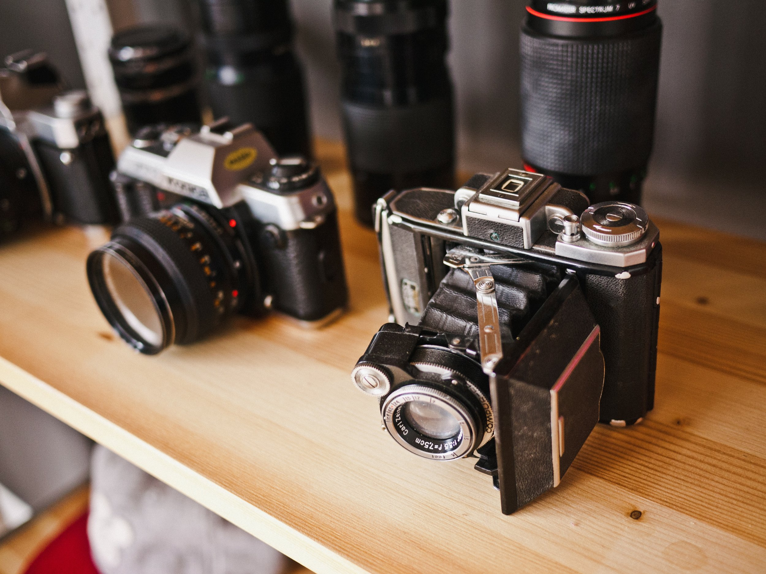 Vintage cameras on a shelf