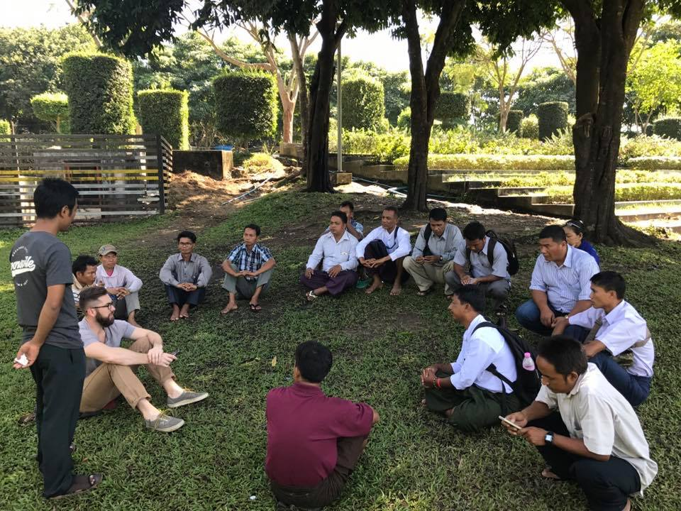 A time of prayer and reflection at a local park in Yangon, Myanmar