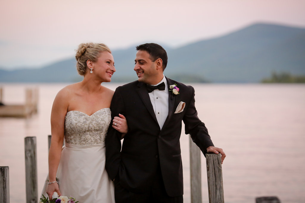 Bride and groom on a dock at The Inn at Erlowest  on Lake George, NY