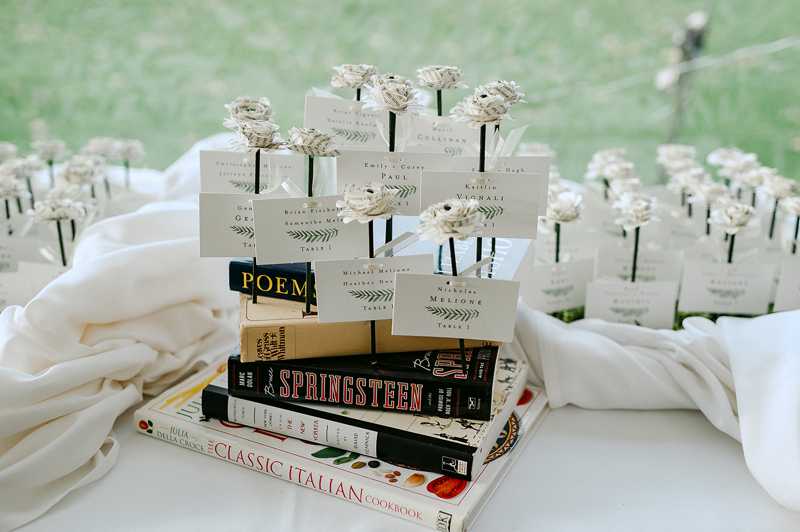 Kaitlin and Nichola's' wedding details were perfect, including these place cards made of pages from Kaitlin's favorite books