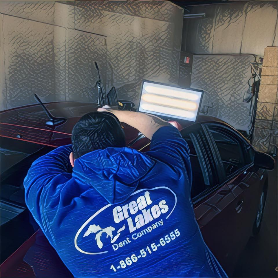 PDR Tech Brandon fixing a hail damaged car.jpg