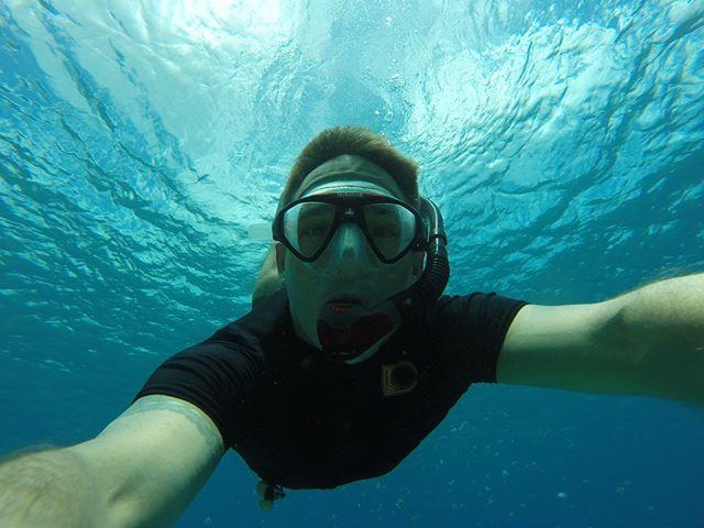 Nothing like swimming with a school of fish. #floattolive #rashguard #snorkel #underwater #swim #swimming #snorkeling #fish #marinelife #ocean #guam