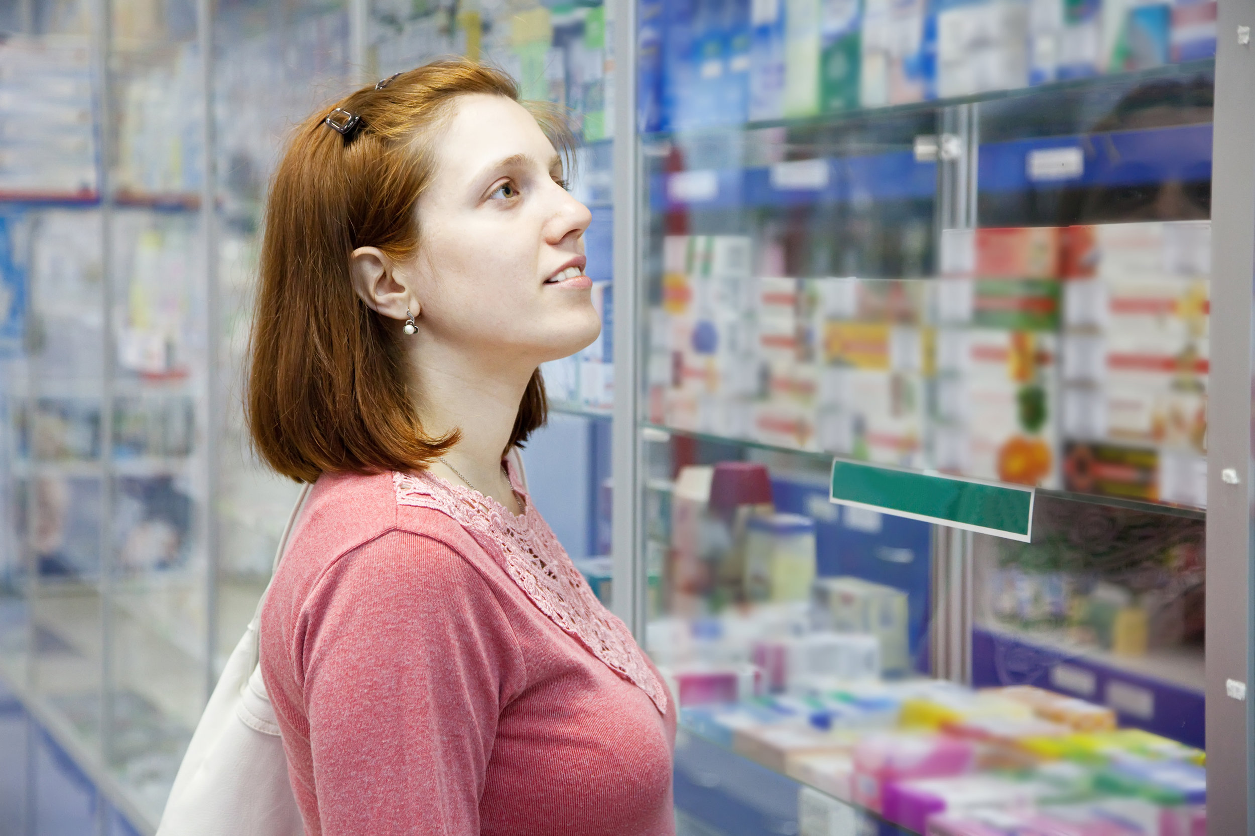 Woman near counter in pharmacy drugstore_Shutterstock_purchased 2016-11-16.jpg