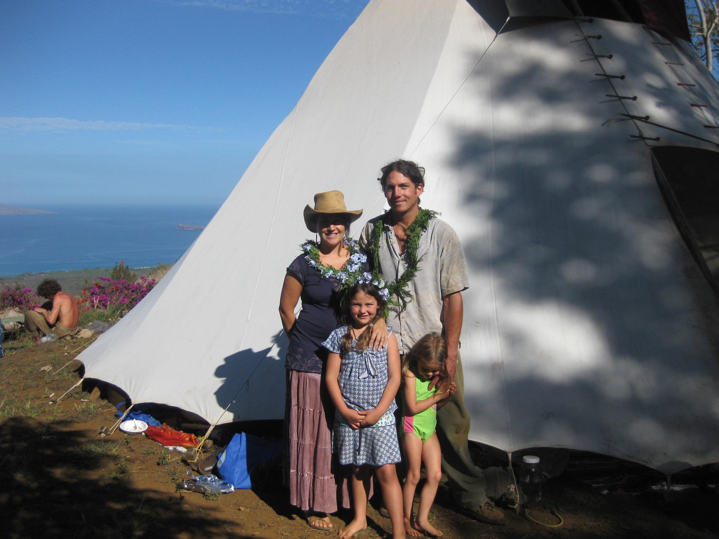 family in front of tipi.JPG
