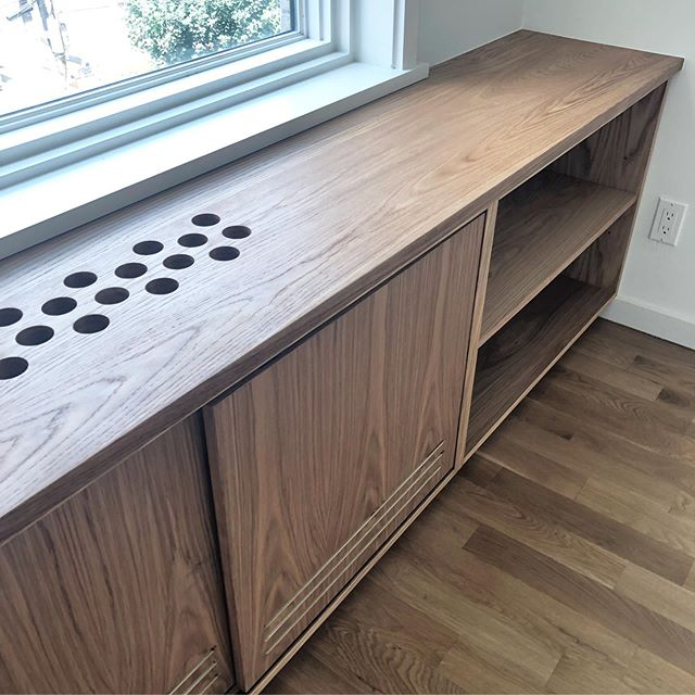 White oak built-ins with integrated vent for HVAC unit.