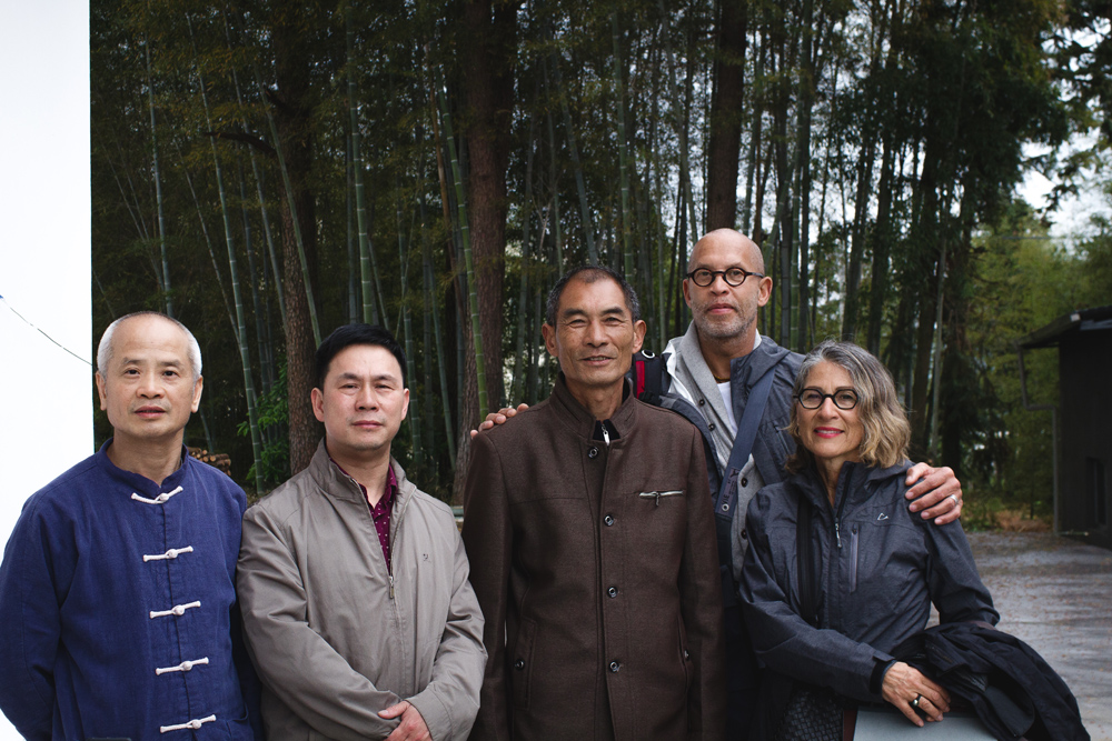 From left, Dr. Ming Wu, Tea Master Xu, his Uncle, Nathaniel & Michele Vinson outside their tea factory and warehouse in Wuyi Mountain.
