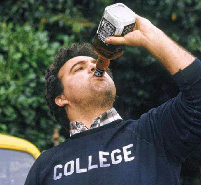 wonderful-animal-house-drinking-game-4-john-belushi-illustrates-all-too-well-bottle-madness-in-1978-gross-out-movie-690-x-638.jpg