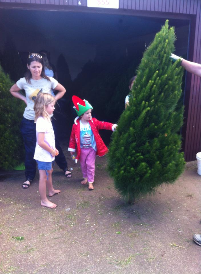 kids in front of tree shed.jpg