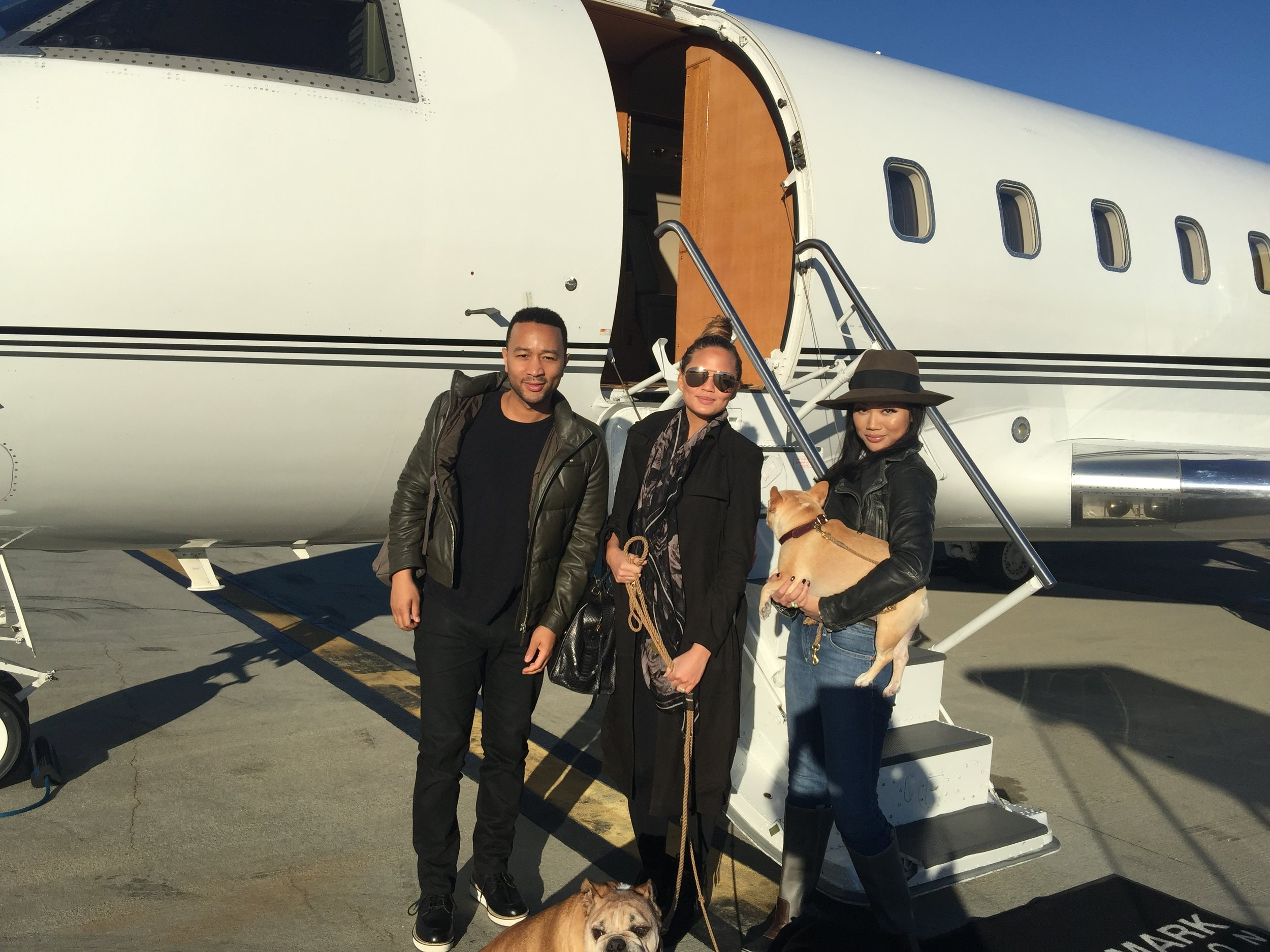 Tina with her sister, Chrissy Teigen, and her brother-in-law, John Legend + the canine bowwowsters