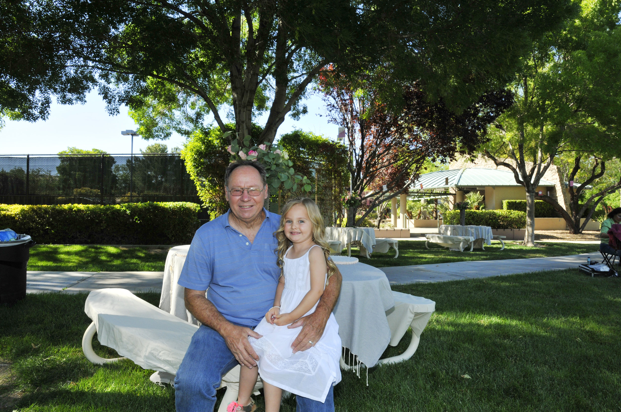 Grandpapa with his grandgirl, Ava.  Photo by Trevizo Photography.