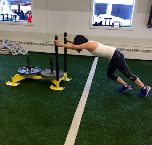 Veteran client Elinor crushing sled pushes at Pure Performance Training this past month.