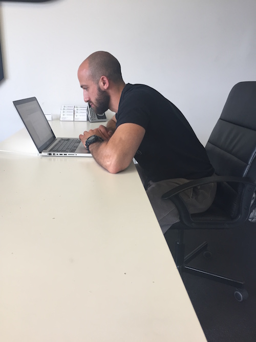Over rounding your upper back and reaching your head out towards your computer can lead to your pecs and neck feeling tight